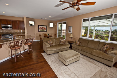 Open Concept Living Room With Adjoining Dining Area And Kitchen